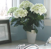 Flowers and other accessories create a show home environment.