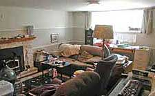 Basement a chaos of clutter before staging by Debra Gould